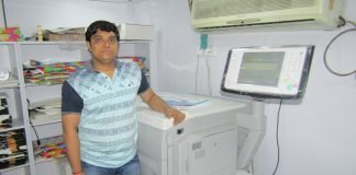Pravin Patel, owner of King Digital with the Canon imagePRESS C850