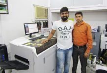 Dharmik Karia, proprietor and Sandesh Jadhav, manager of Jumbo Xerox with the new canon press