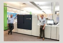 Bill Conlin (left) and Bill Conlin Jr. (right) stand alongside their newly installed Xerox Iridesse Production Press.
