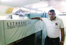 Paresh Chaudhary, director, Krishna Multiprint with the Komori Lithrone A37. Photo IPP