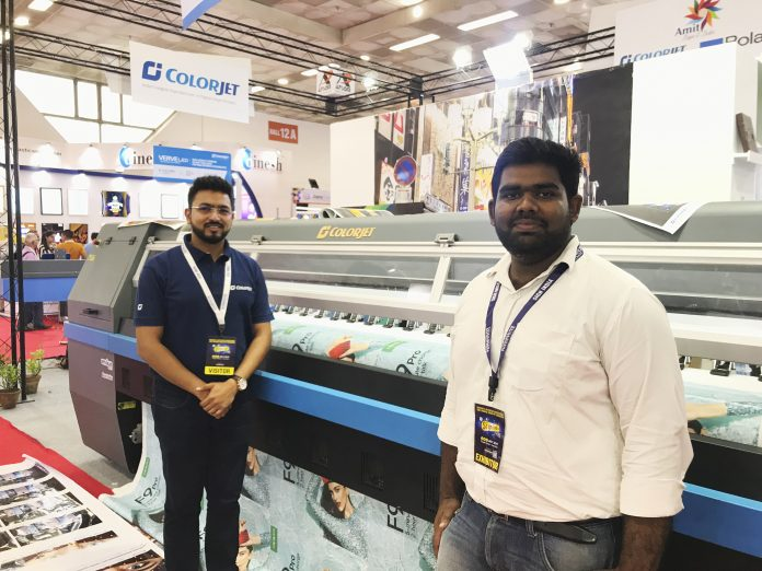 Smarth Bansal, senior product manager at Colorjet India alongside a printer displayed at the stand. Photo IPP