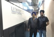 Baljeet Singh, the owner of Royal Offset and his son Amanpreet Singh alongside the new Komori GL 537 offset press at their plant in New Delhi. Photo IPP