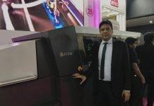 TP Jain of Monotech Systems along side Scodix Ultra digital enhancement press at Pamex 2020. Photo IPP