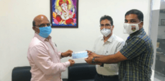 C Ravinder Reddy, the president of TOPA, presenting a cheque of Rs. 10 lakhs to Dayakar Reddy national coordinator of TOPA and Radhakrishna, treasurer of TOPA