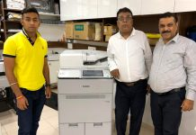 The Sonal Xerox team with the new Canon C165 digital press at its new branch in Ahmedabad